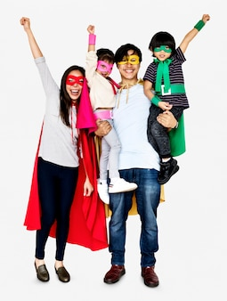 Happy family wearing superhero costumes