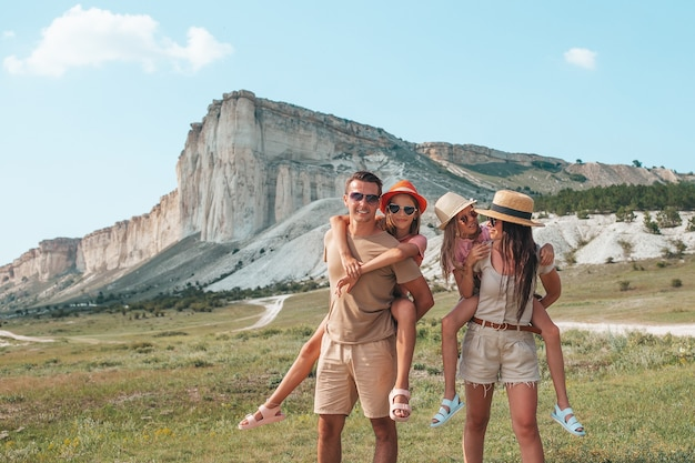 Happy family with beautiful landscape on vacation
