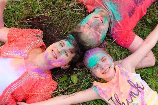 Happy family with holi painted faces