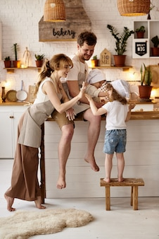 Happy family with their children cooking in the kitchen