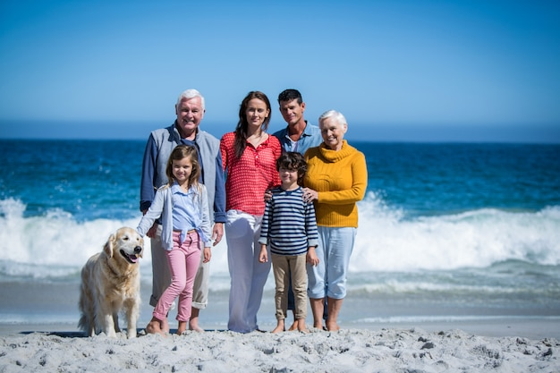 Happy family with their dog at the beach