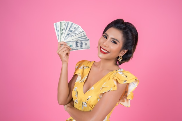 Happy fashion beautiful woman hand holding dollar money