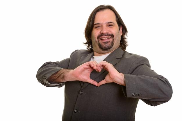 白で隔離の手のハートのサインを作って笑って幸せな太った白人ビジネスマン