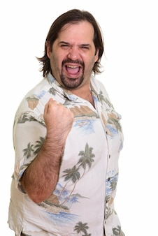 Happy fat caucasian man smiling and looking motivated with arm raised