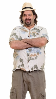 Happy fat caucasian man smiling with arms crossed ready for vacation