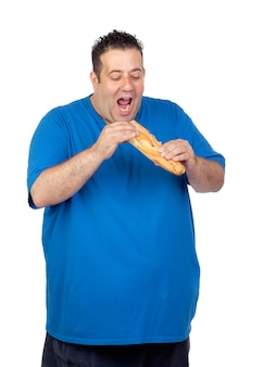 Happy fat man eating a large bread isolated on white background