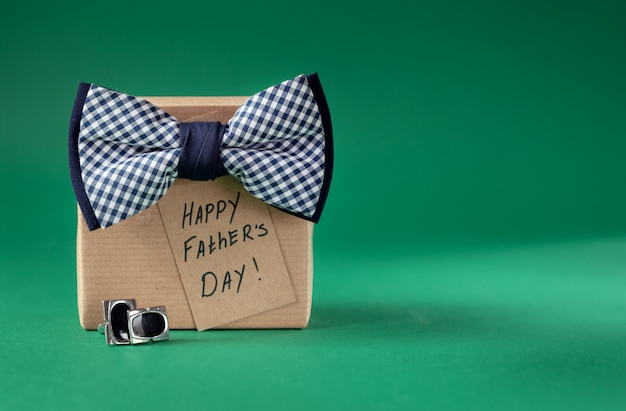 Happy father day greeting card with tag on green