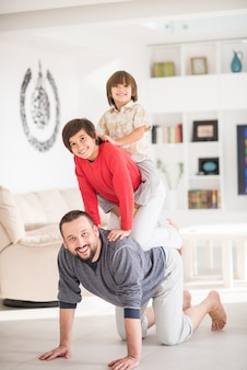 Happy father and kids at new modern home