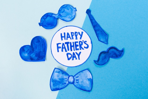 Happy father's day with glasses, tie, heart and more blue drawings on light and dark blue background