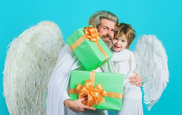 Happy father and son angels with presents. valentines day. valentine cupid with gift box.