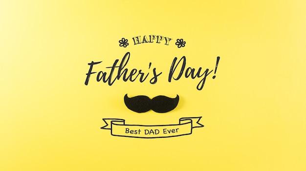 Счастливый день отцов фон концепция с черными усами и текст на пастельно-желтом фоне