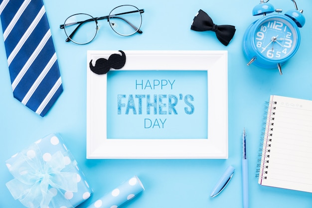 Happy fathers day concept on blue pastel background. flat lay.