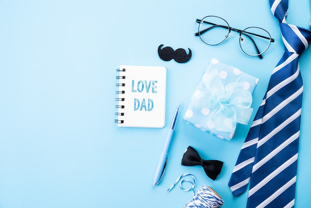 Happy fathers day concept on bright blue pastel background in flat lay