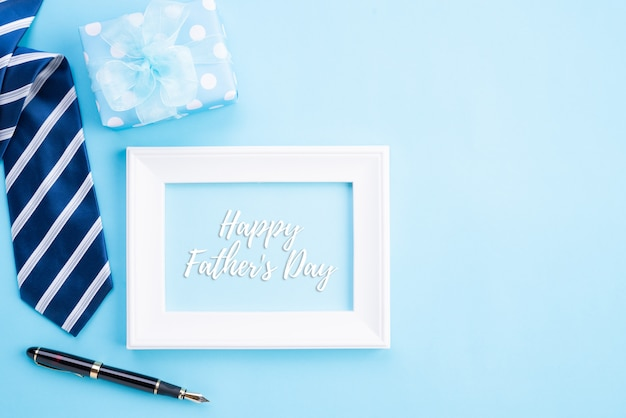 Happy fathers day concept on bright blue pastel background.