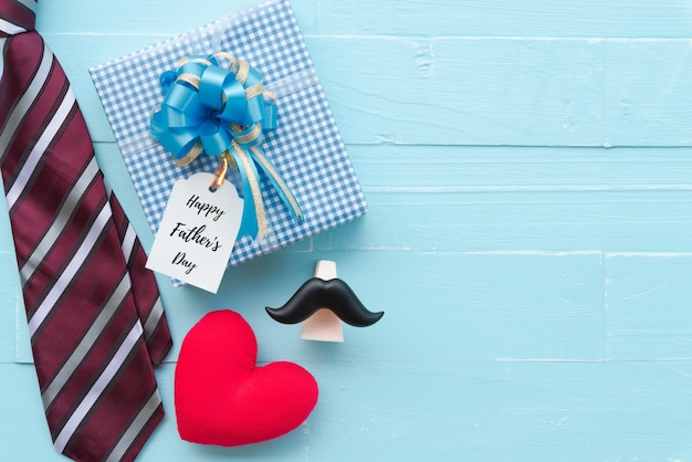 Happy fathers day concept on bright blue pastel wooden table background.