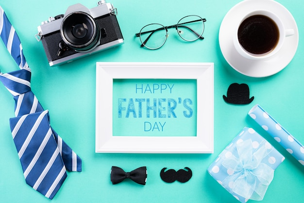 Happy fathers day concept on bright green pastel background.