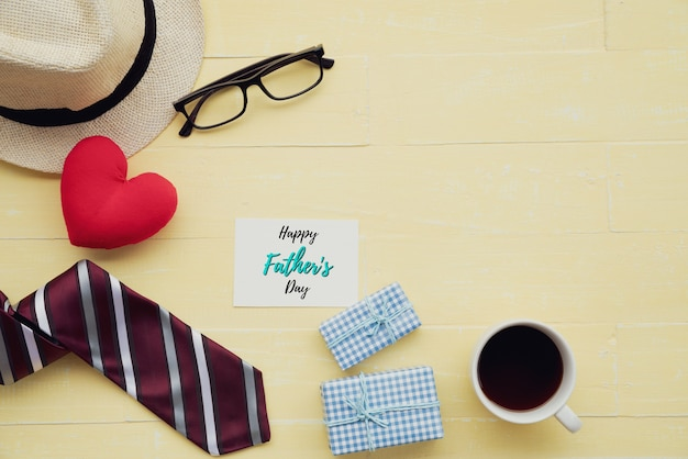 Happy fathers day concept on bright yellow pastel wooden table background.