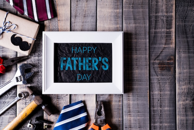 Happy fathers day concept on dark wooden table background in flat lay