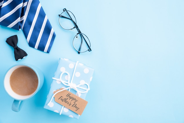 Happy fathers day concept. top view of blue tie, beautiful gift box, coffee mug