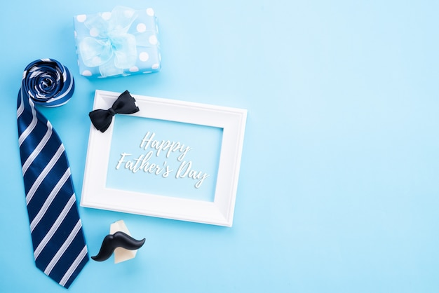 Happy fathers day concept. top view of blue tie, beautiful gift box