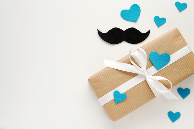 Happy fathers day, gift box and mustache