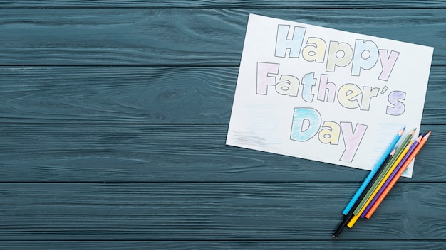 Happy fathers day inscription with pencils