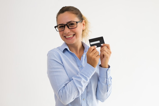 Happy female cardholder advertising loyalty program
