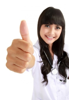 Happy female doctor with thumb up
