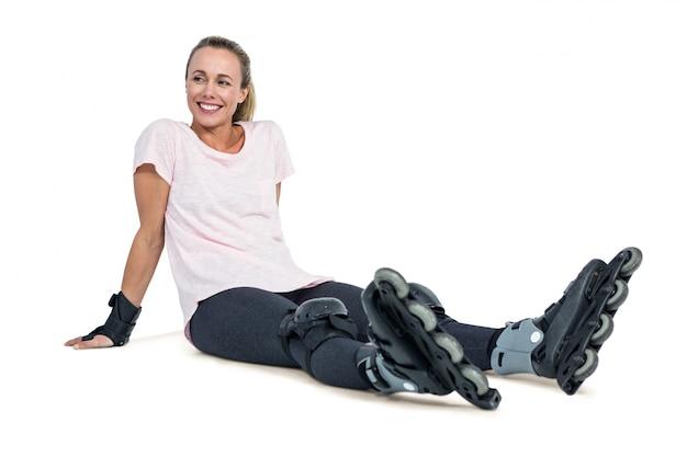 Happy female inline skater relaxing