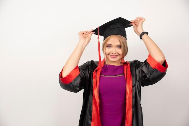 Happy female student posing on white.
