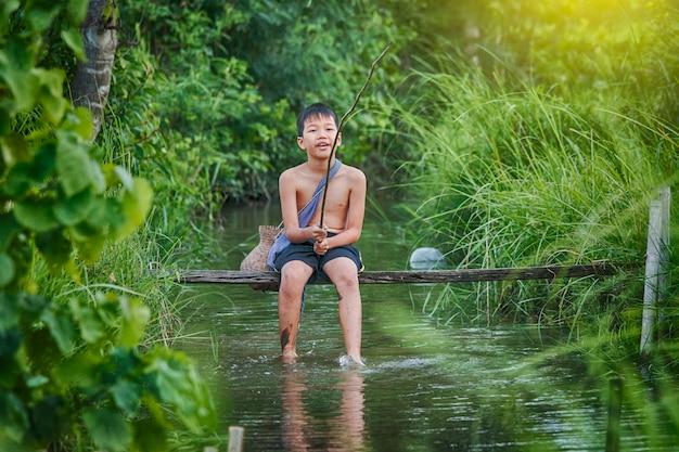 Happy fishing children in rice field