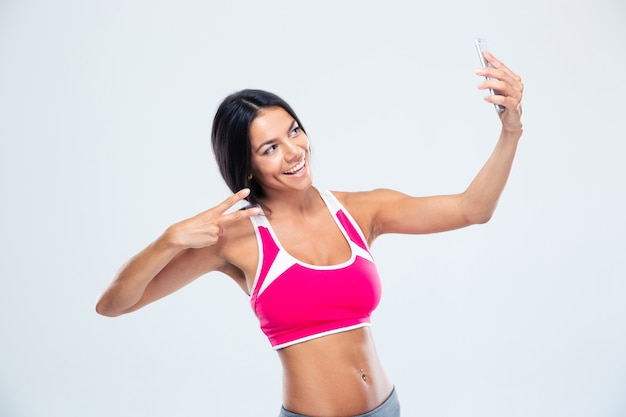 Happy fitness woman making selfie photo