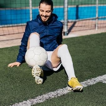Happy football player training