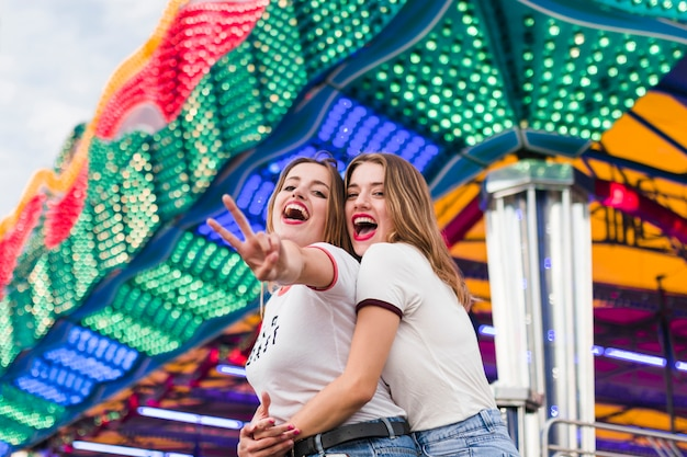 Happy friends in the amusement park