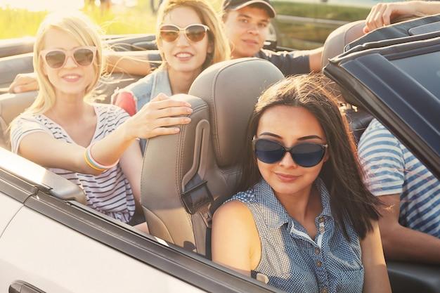 Happy friends in car