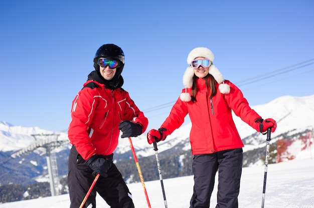 Happy friends going to ski in winter vacation - young coulpe having fun doing extreme sport - friendship and holidays concept