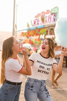 Happy friends having fun in the amusement park