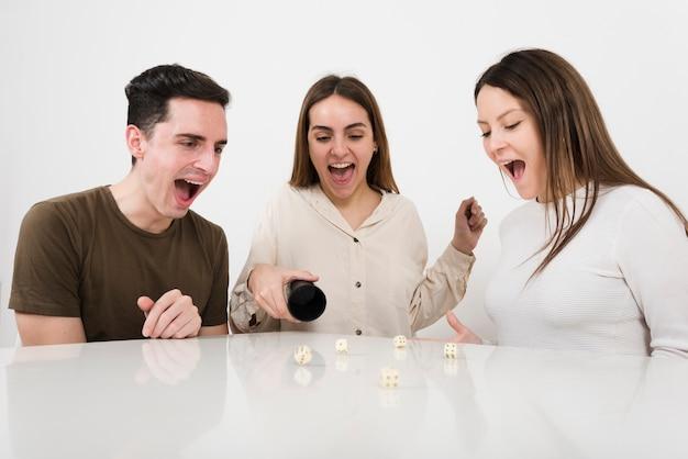Happy friends playing yahtzee