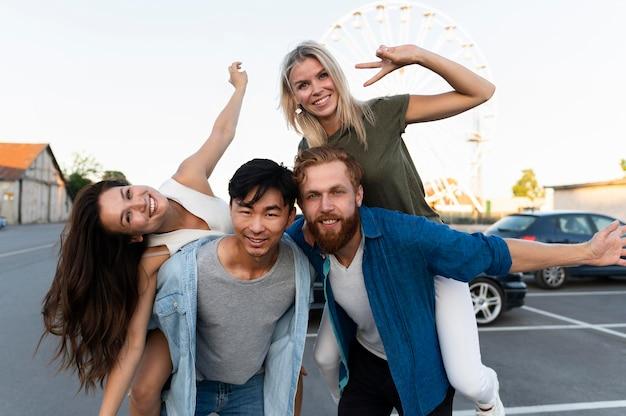 Happy friends posing on street
