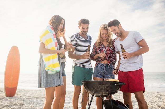 Happy friends preparing barbecue