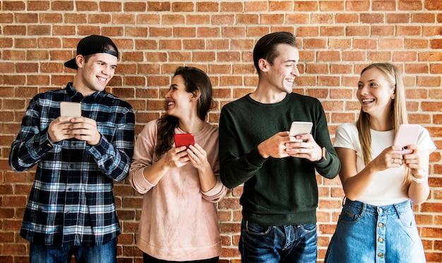Happy friends using smartphones social media concept