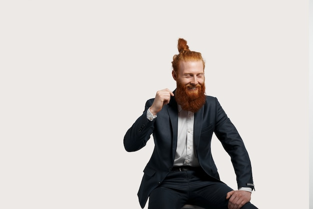 Happy and funny businessman laughs isolated