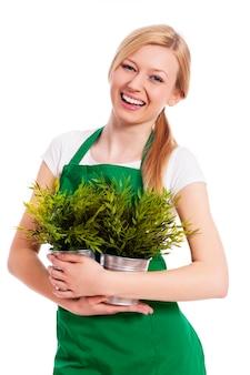 그녀의 식물을 가진 행복 한 정원사 여성