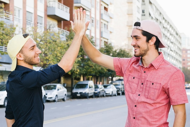 Happy gay couple giving high five
