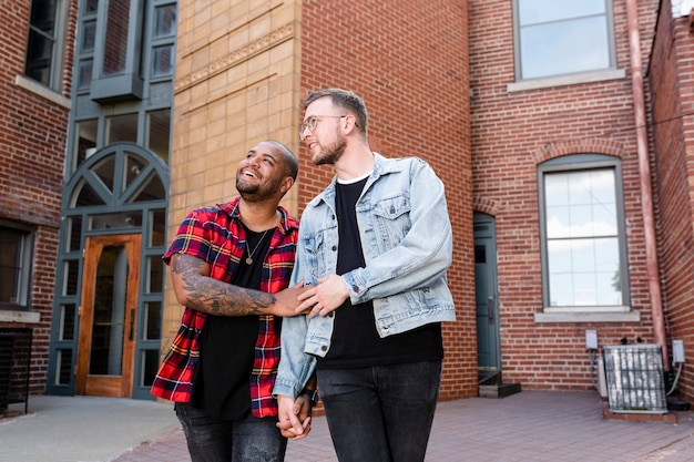 Happy gay couple walking in the city, lifestyle stock image