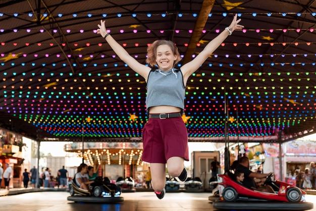 Happy girl at amusement park