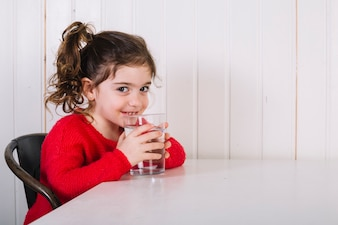 Happy girl drinking water