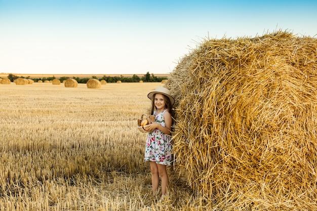 Happy girl on field of wheat