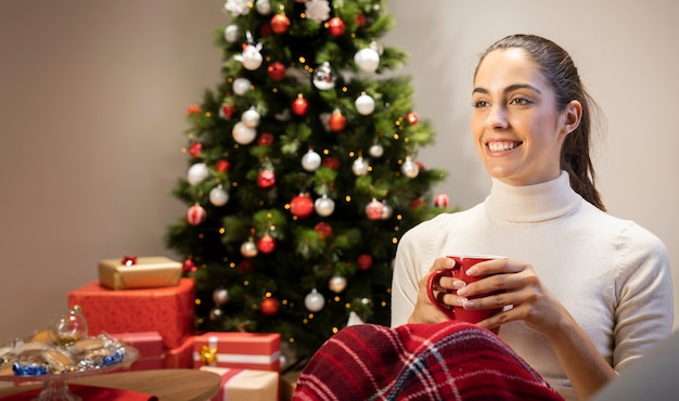 Happy girl holding a cup of tea