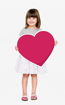 Happy girl holding a heart icon